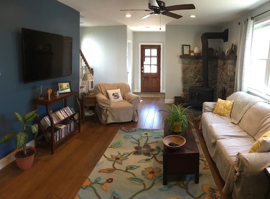 Family room with wood burning stove. This room has a built-in heat and AC unit that keeps the downstairs comfortable during warmer months.
