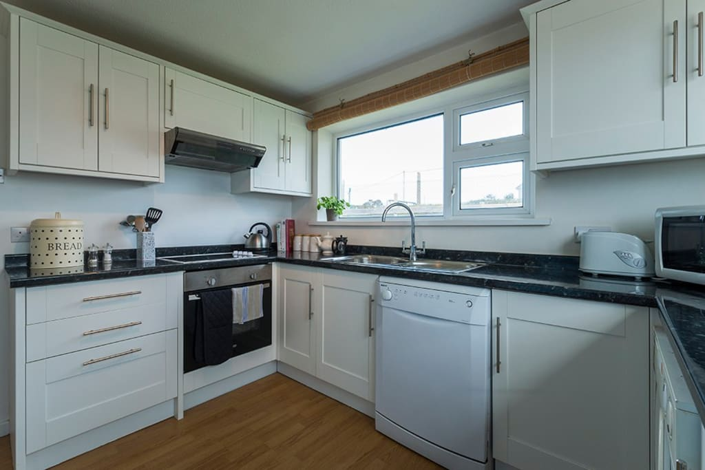modern kitchen with dishwasher and washing machine
