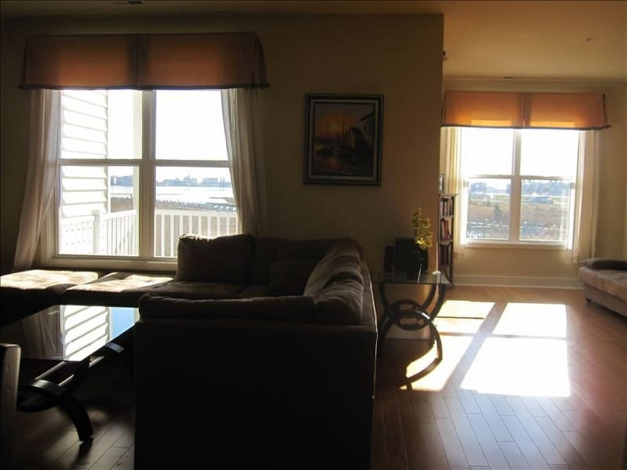 Living room with plenty of sunlight and view of the bay
