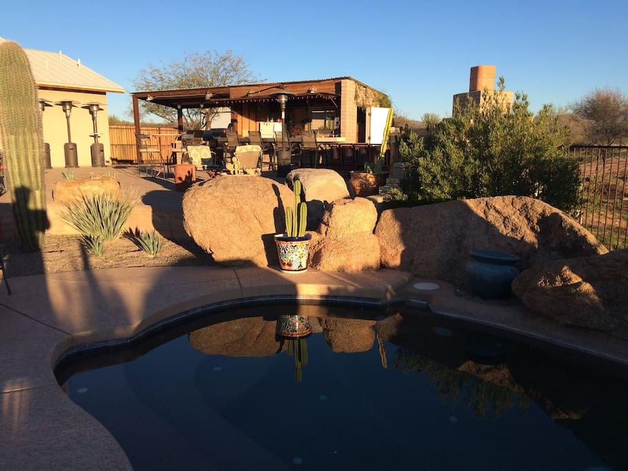 The lower patio features a spool (small pool), loung chairs and table with umbrella and chairs.
