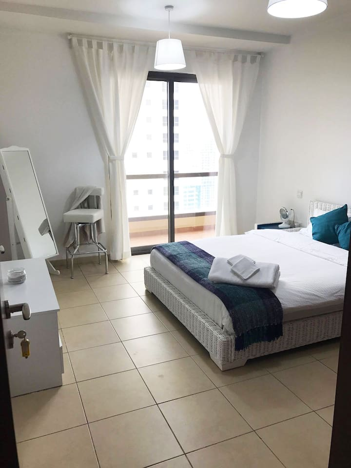 Queen bed for guests.  Comes with Towels, blankets, closet space, tall mirror, balcony access.  It comes with your own private bathroom across the doorway.