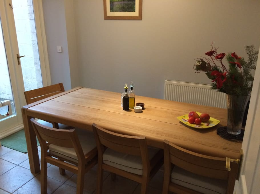 Here is a view of the large kitchen table which accommodates 8 people.  The door to the left leads straight into the rear garden.