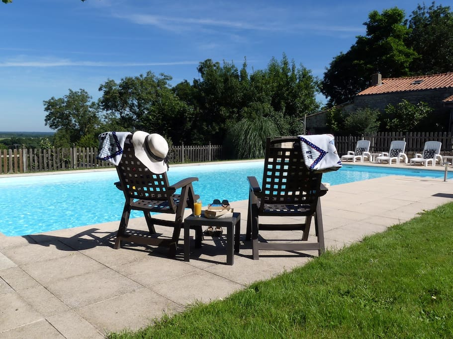 Relax by the heated pool at Le Vieux Café.