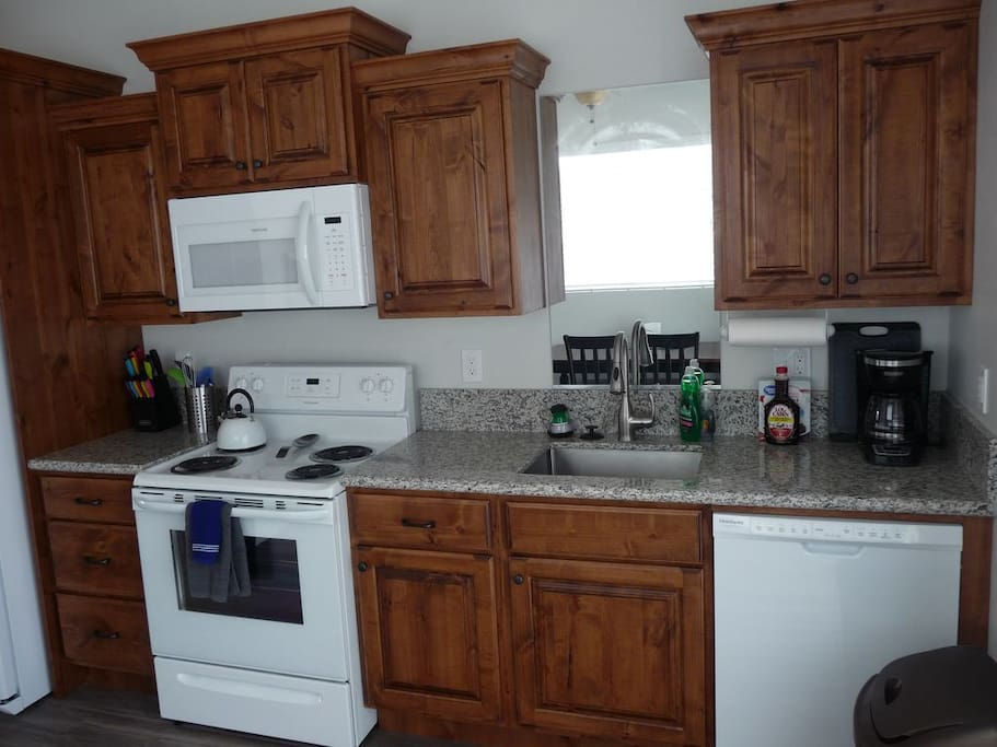 The kitchen has Alder cabinets and full size appliances