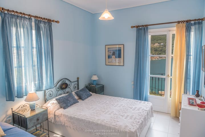 The blue bedroom, breezy and cosy.