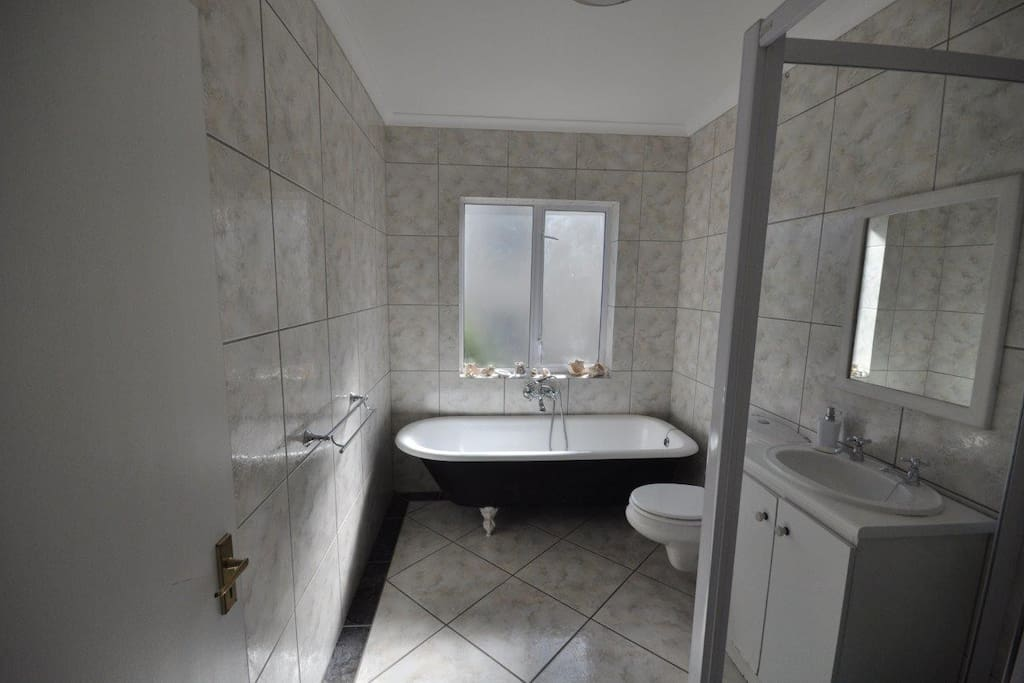 Victorian bath and separate shower downstairs