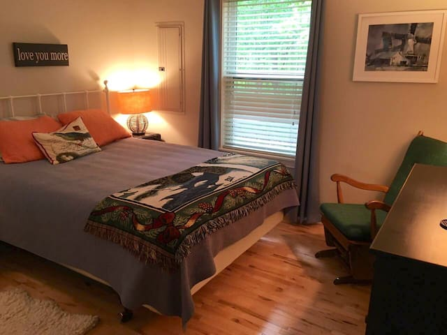 There are two identical bedrooms in the cabin, both overlooking the woods