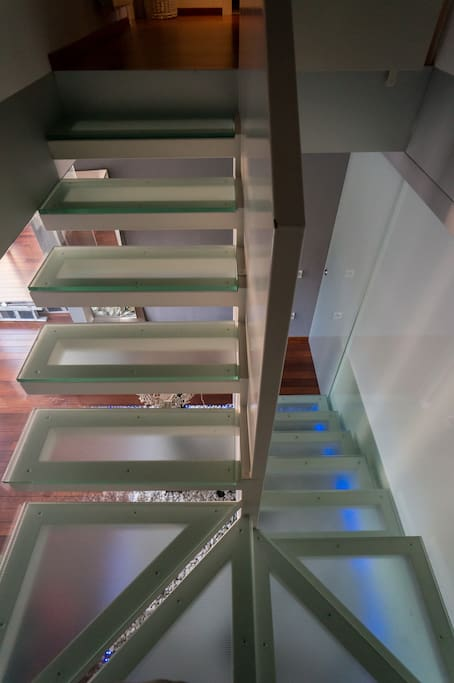 Stairs especially designed for our house with blue led lights.