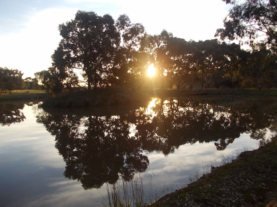 Watch the sun go down over the dam 2 minutes' walk from the verandah