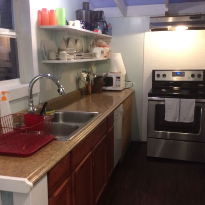 Light and bright describes this well appointed kitchen, perfect for your food preparation projects. This kitchen is shared with, one other guest. There are shelves for your private kitchen items.