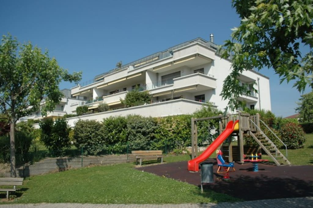 Building with children's playground.  The apartment is on the top floor.