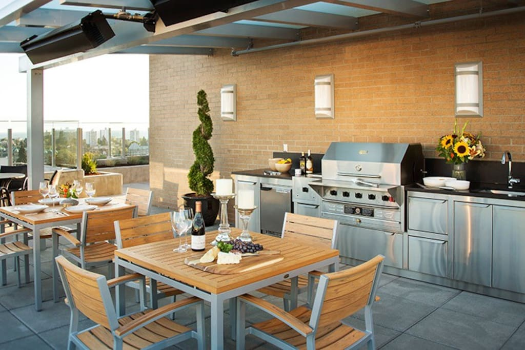 communal BBQ with fridge, seating and outdoor heaters