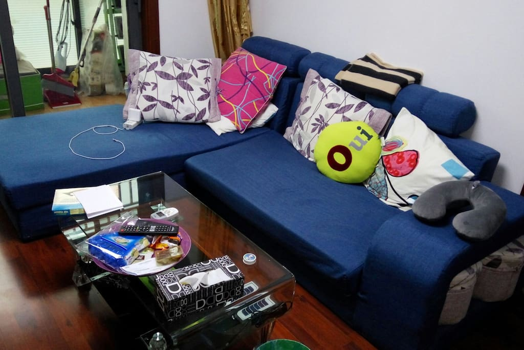 L-sofa in front of the TV table