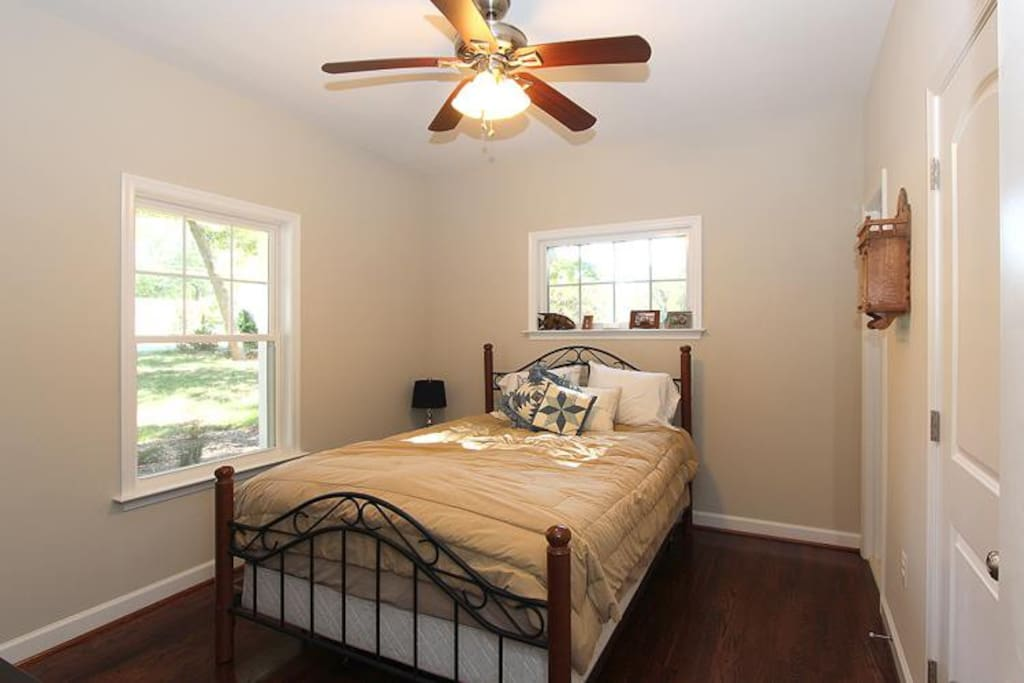 Private bedroom with large closet and hardwood floors