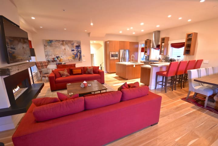 Spacious great room with kitchen and dining area.
