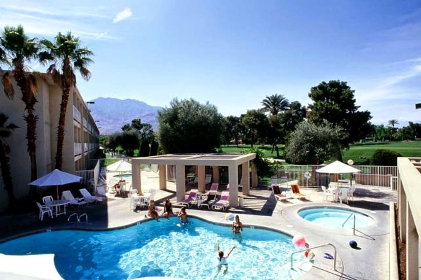 Enjoy the refreshing swimming pool and soothing spa against a magnificent mountain and golf course background.
