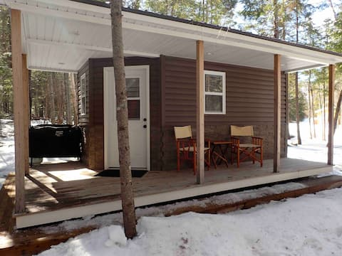 Basic waterfront Cottage, at intimate camp site