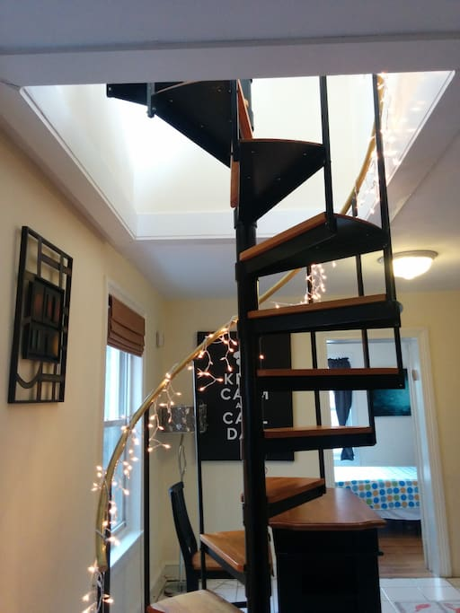Spiral staircase, leading to private deck.