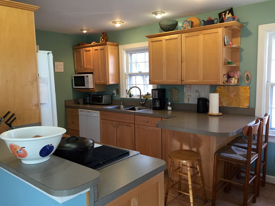 Bright open kitchen with 3 bar stools. Dishwasher, microwave, coffee maker, electric kettle, toaster oven, oven with downdraft vent. Plenty of kitchenware, glassware and pots/pans.