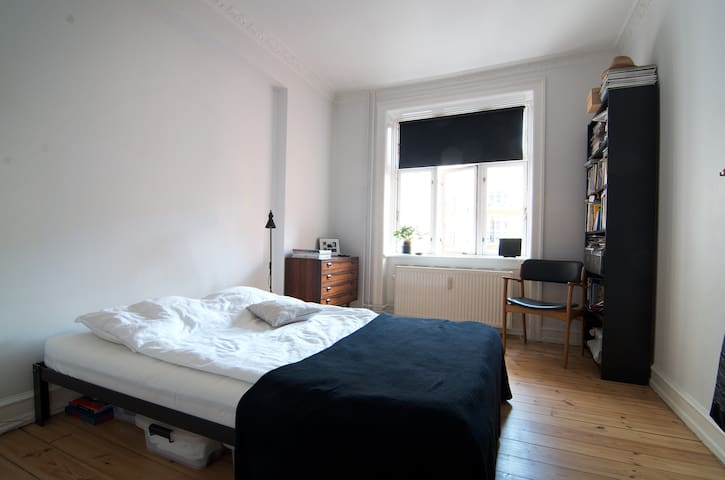 Bedroom with comfortable bed...