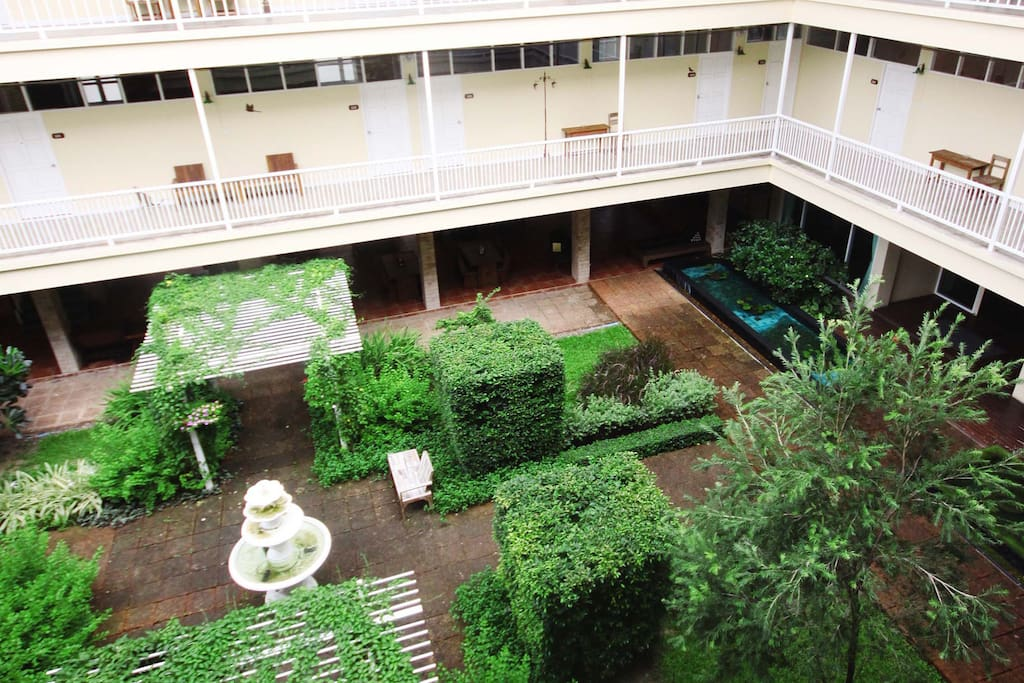 tranquil courtyard in the middle of the building, right in front of your door step.