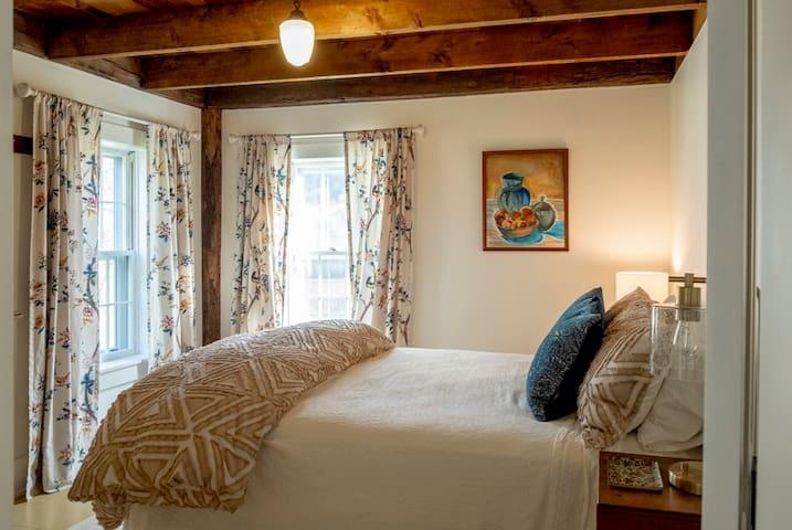 Bedroom 1: Queen with original schoolhouse hand-hewn beams