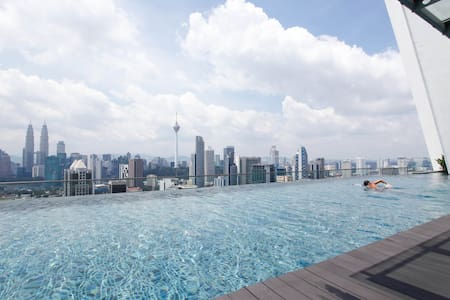 Our warm and comfort brand new studio apartment that located in KL City Centre with famous stunning infinity pool at rooftop with KLCC and KL Tower view.   If this listing is full, please go to our next list: https://www.airbnb.com/rooms/4856295