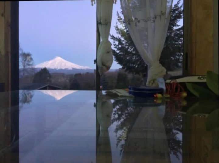 Habitación con baño privado vista al volcán