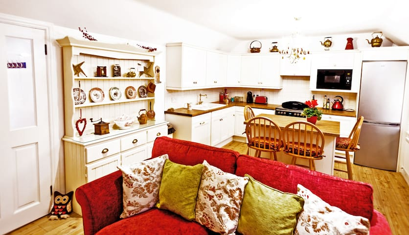 The kitchen and living areas are a combination of mod cons and antique finds from Irish and French flea markets...