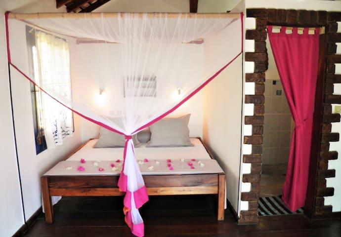La chambre du bungalow double Confort, vue sur la mer