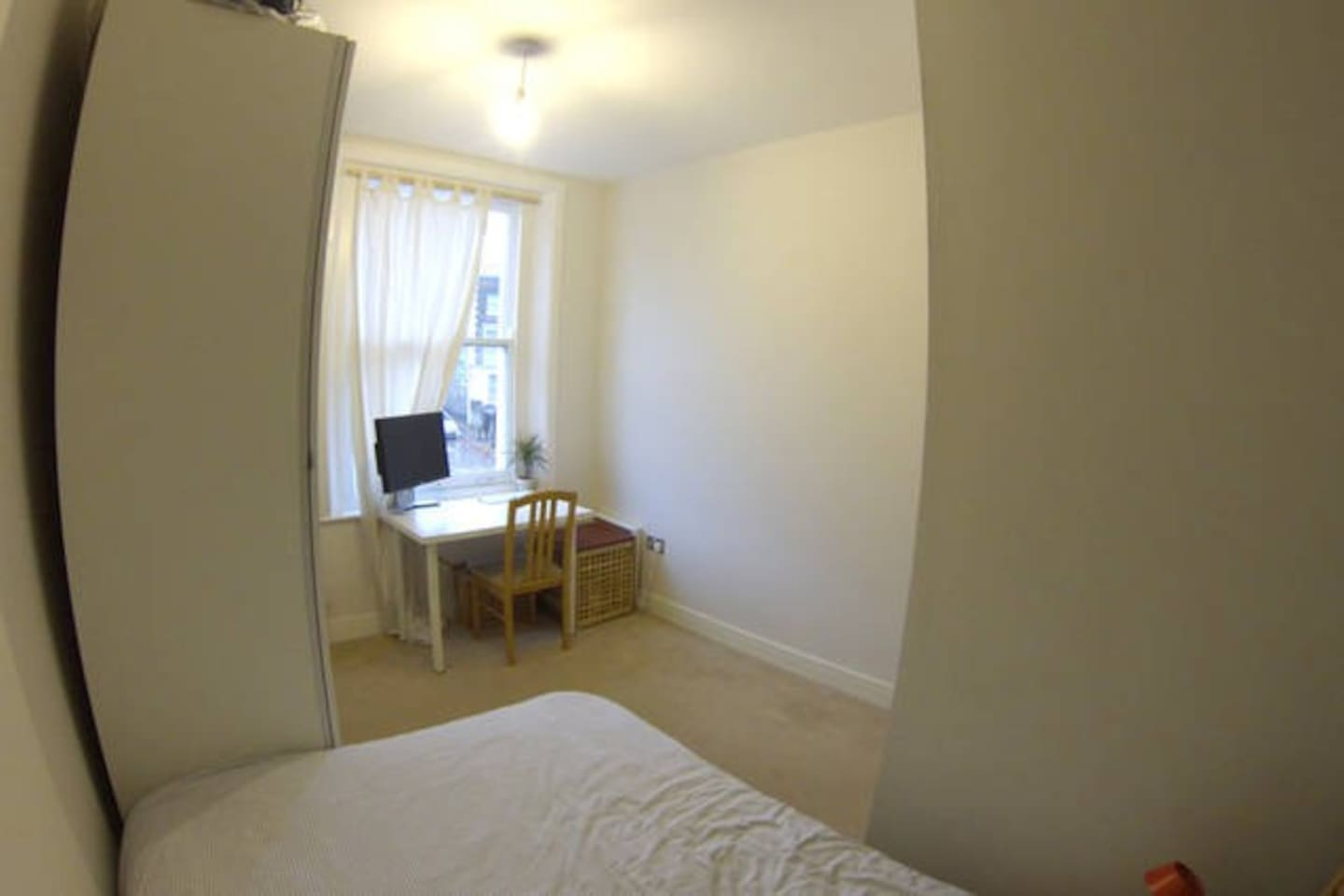 Bedroom no.2: Facing the road, plenty of light and large window. Equipped with desk and chair.