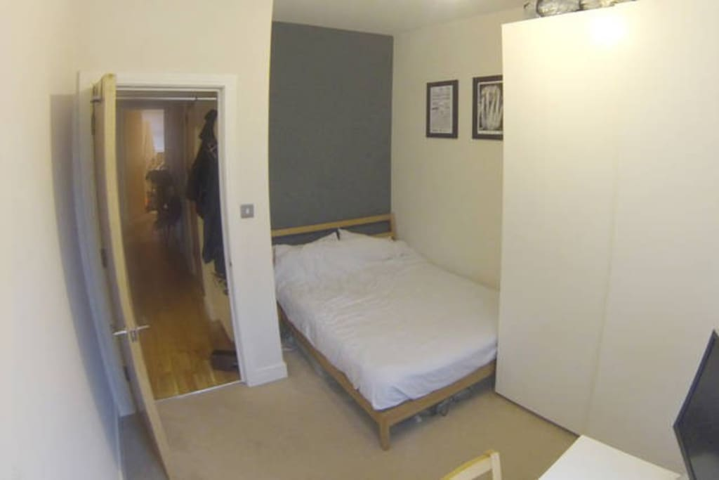 Bedroom no.2: view of wardrobe and double bed. Space to leave your bags and belongings.