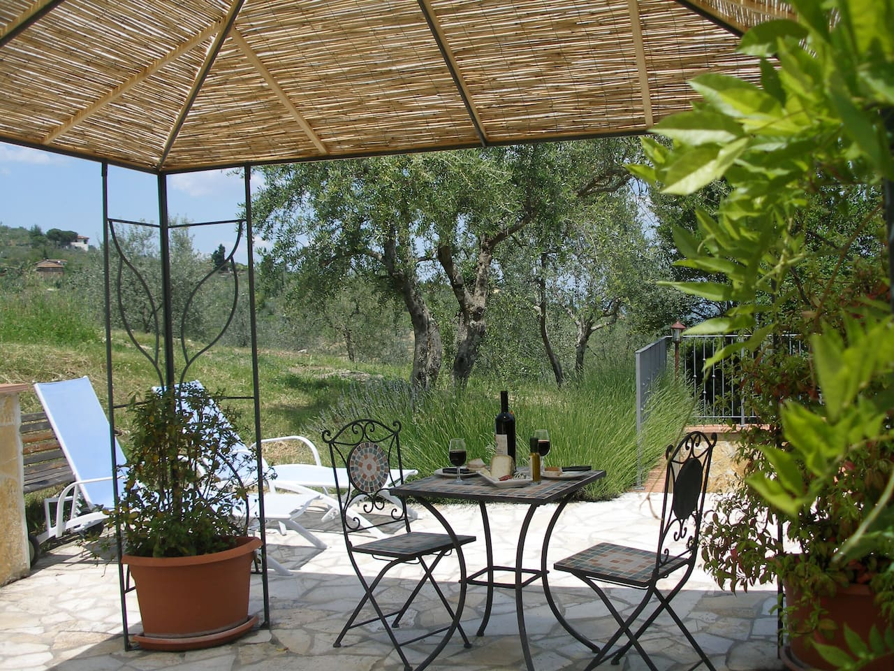 Private Terrace with sun loungers and dining area