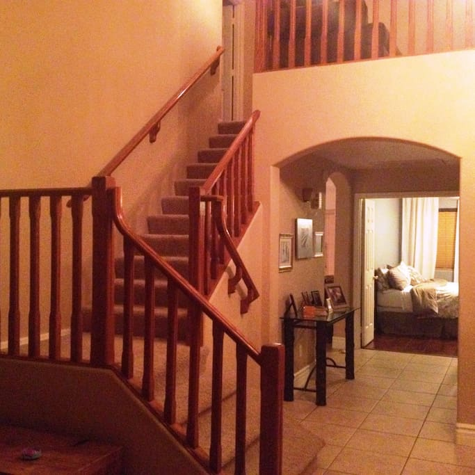 Stairs up to second floor -- downstairs bedroom down the halll.