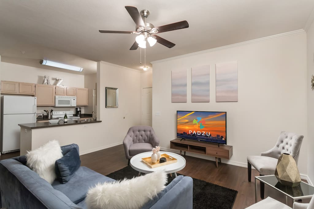 Invite over friends to enjoy the spacious living room area.