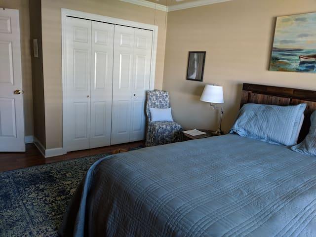 Another view of queen bed bedroom