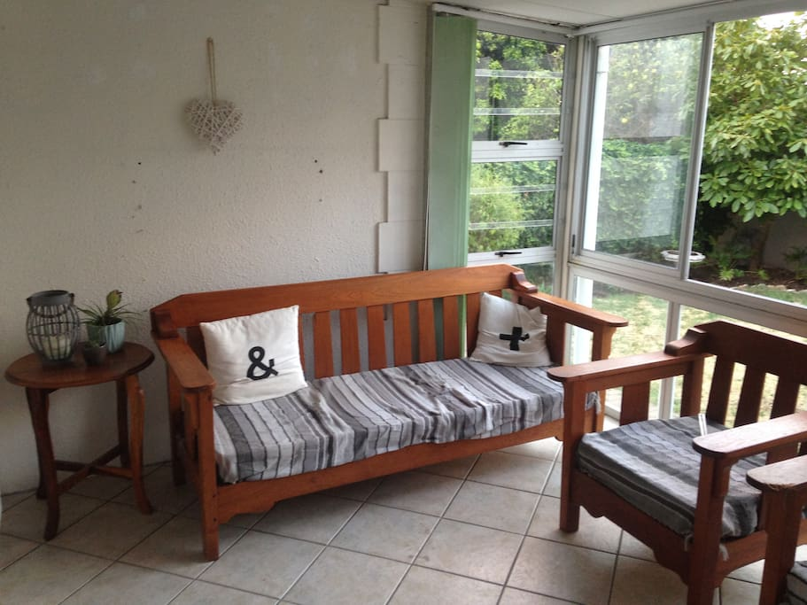 The sunroom is an extra room built onto the front of the house - a great spot to enjoy the morning or afternoon sun.