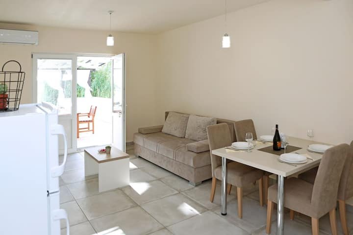 Modern  ground floor apartment with private terrace only 200m from the sea