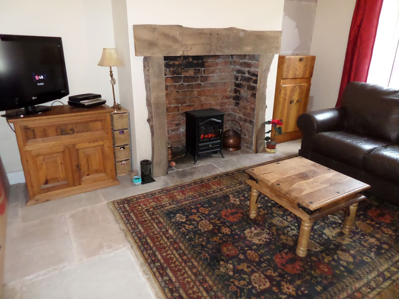 stone floor with under floor heating and inglenook fire place