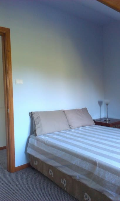 Bedroom, double bed with window seating & mountain views.