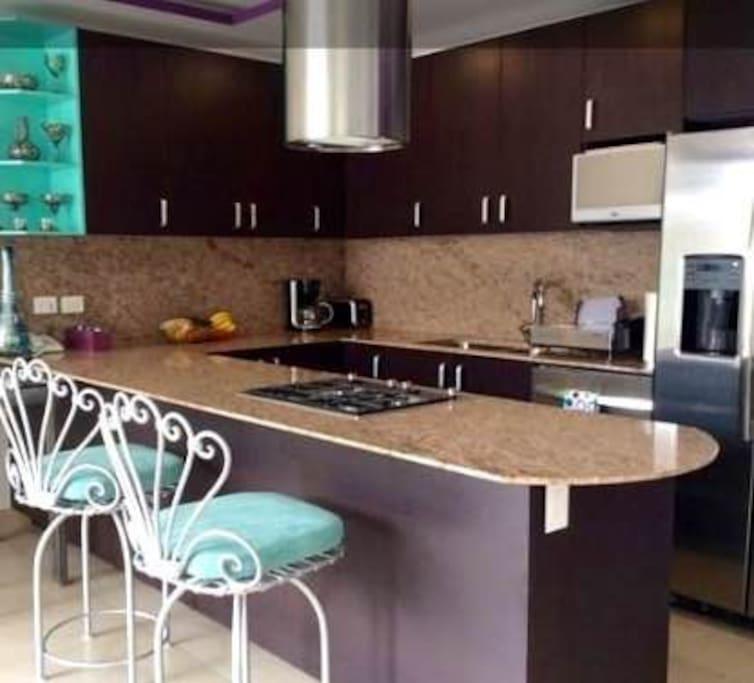 Kitchen and kitchen bar
