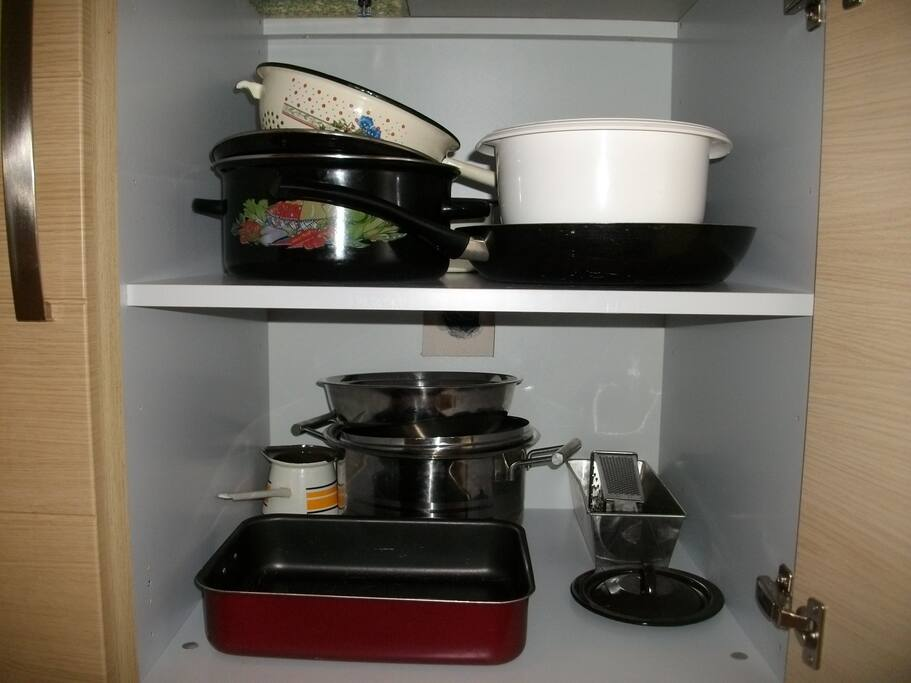 All the pots and pans with other cooking items to prepare a full meal!