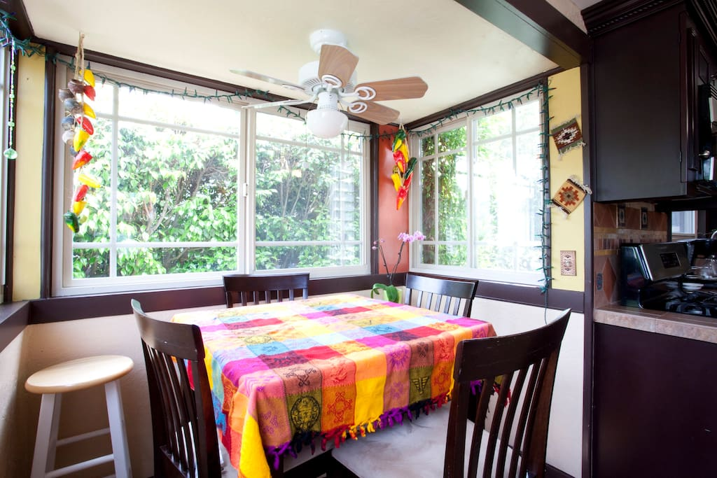 lots of windows around Kitchen Nook to enjoy the view of private backyard -