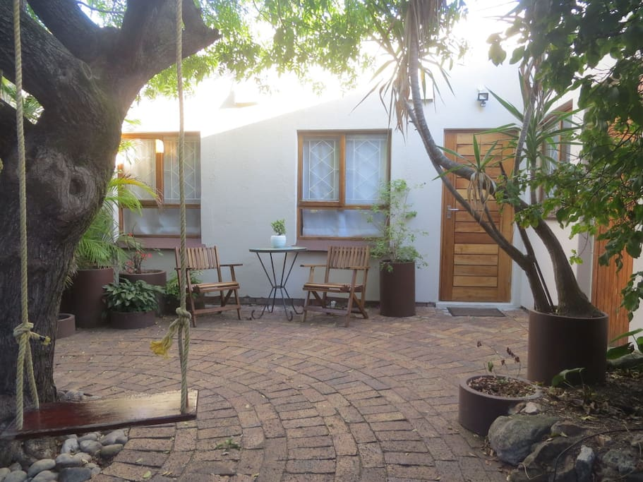 The one-bedroom studio flatlet is separate from our family home with private access via a shared courtyard.