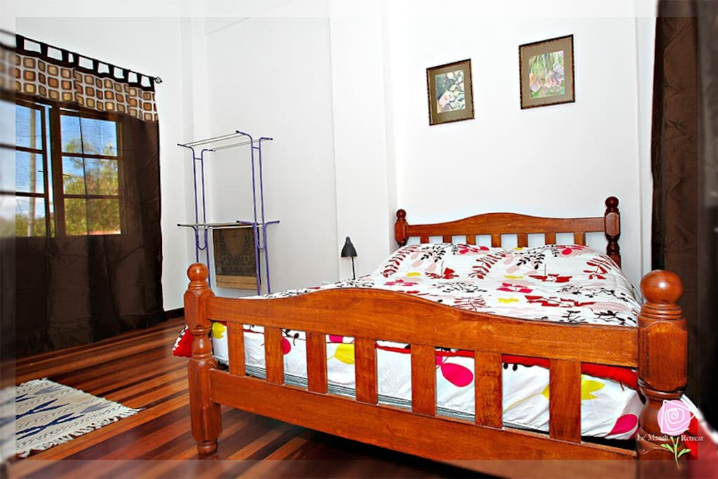 Each bedroom has a Queen sized bed and ample space for an extra mattress on floor.