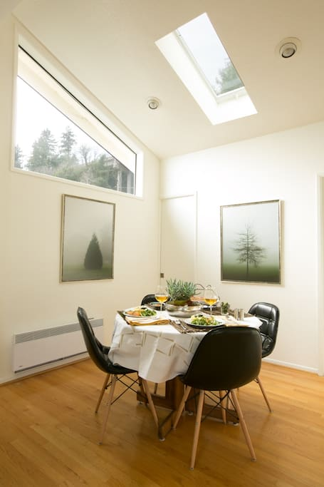 Intimate dining space with views into the treetops.