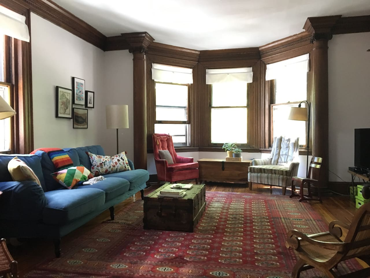 The sunny family room has a bay window with park views.