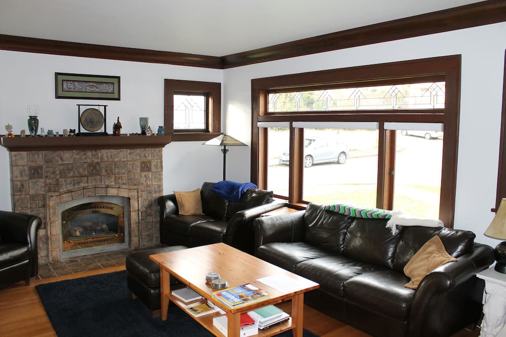 Living room includes pullout sofa and gas fireplace