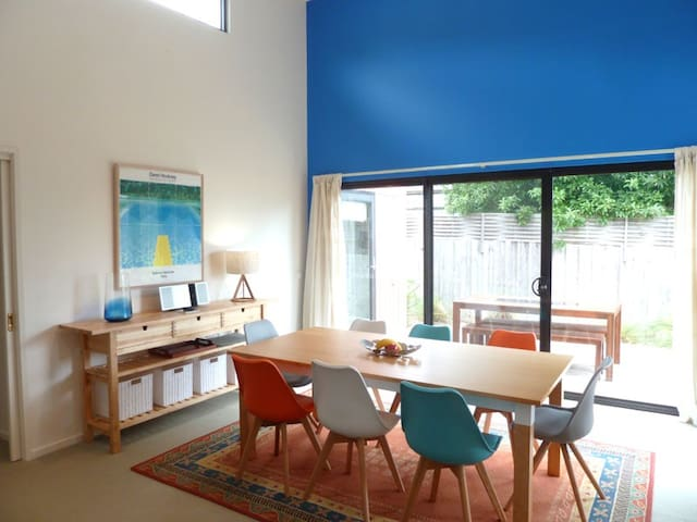 Open plan  dining for 8, access via sliding doors to rear deck and BBQ