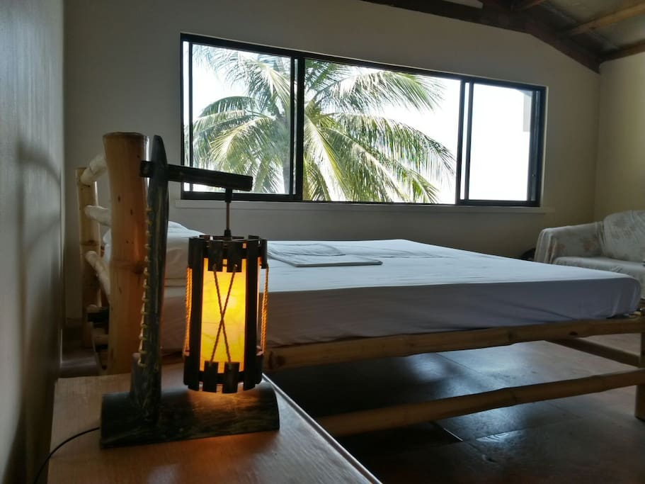 Upper bedroom with a stunning ocean view, airconditioned